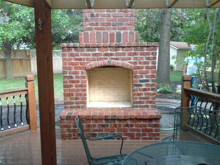 Brick outdoor fireplace fireplace design ideas for Back to back indoor outdoor fireplace