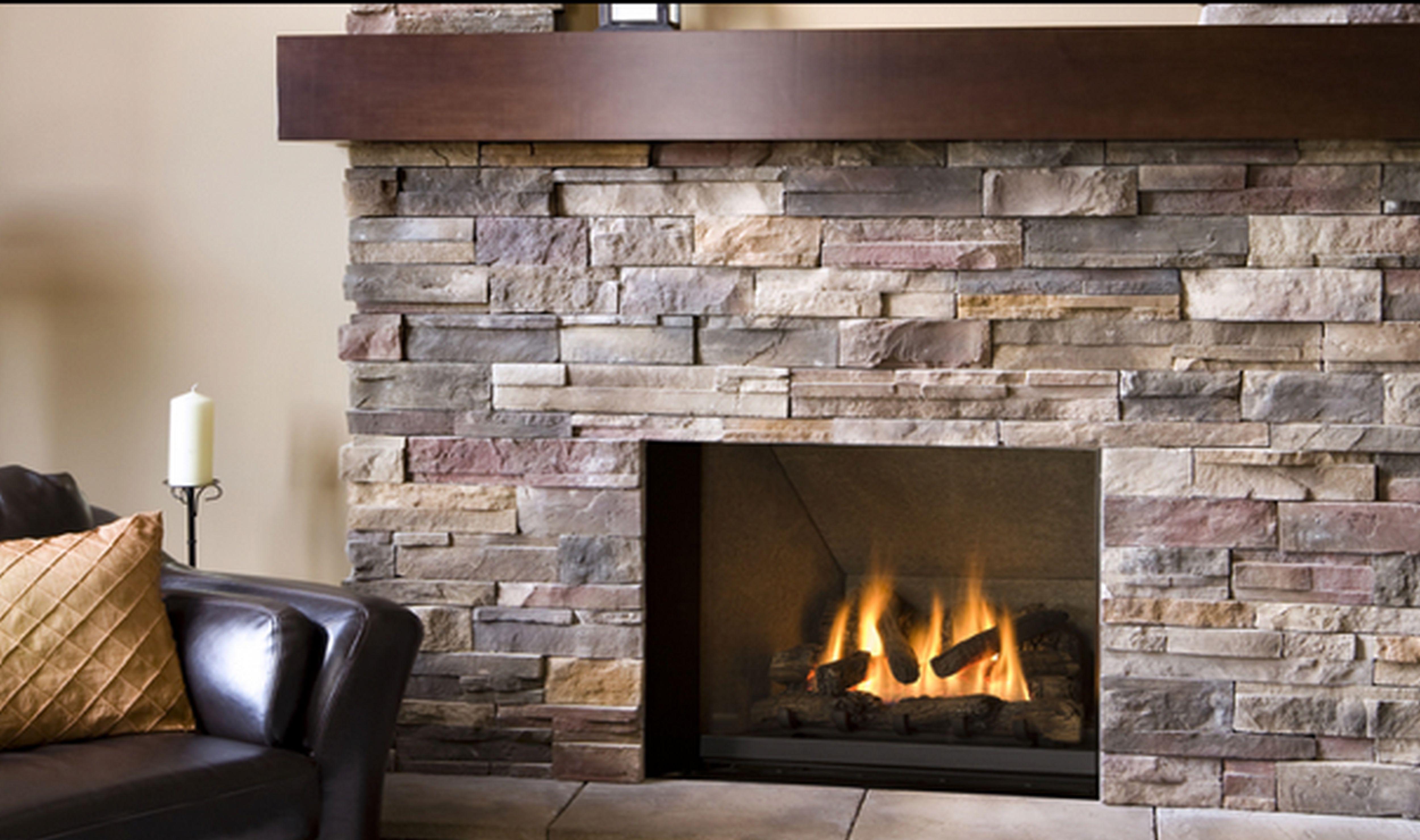 Diy faux stone fireplace fireplace design ideas for Diy rock wall fireplace