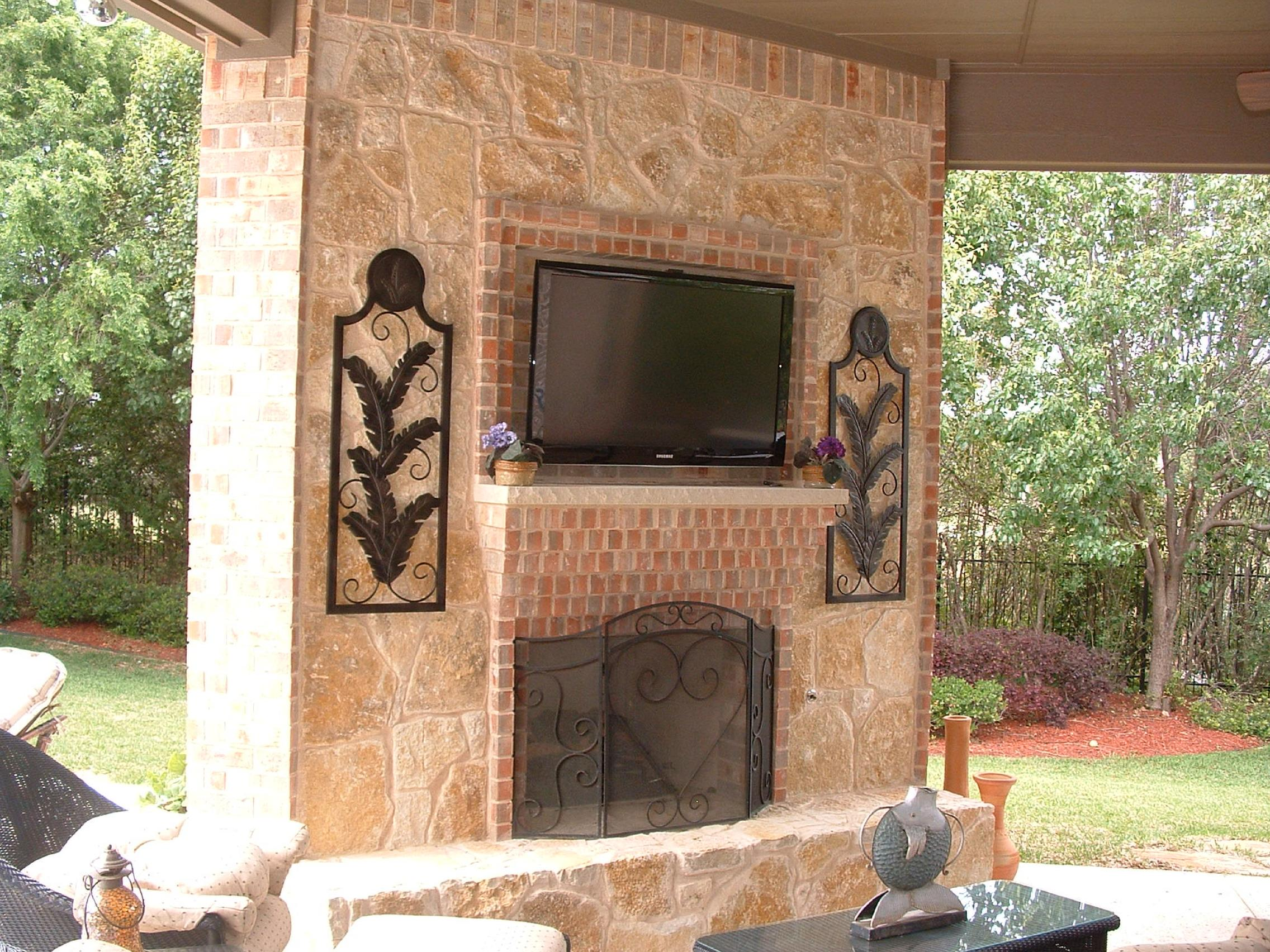Faux stone fireplace is a bud solution for your home