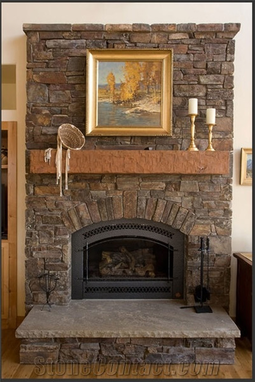 surround faux fireplace tv shepherd new design rotate stone with a flatscreen ledgestone marbella maris afters