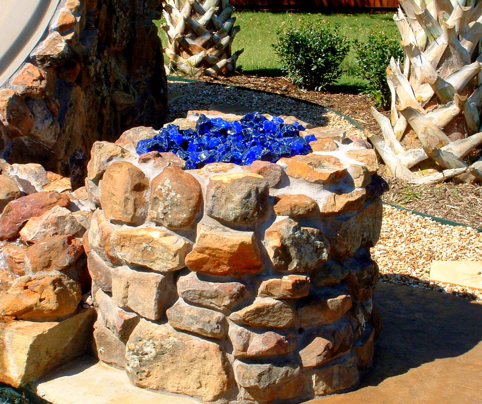 Fire pit rocks fireplace design ideas for What rocks to use for fire pit