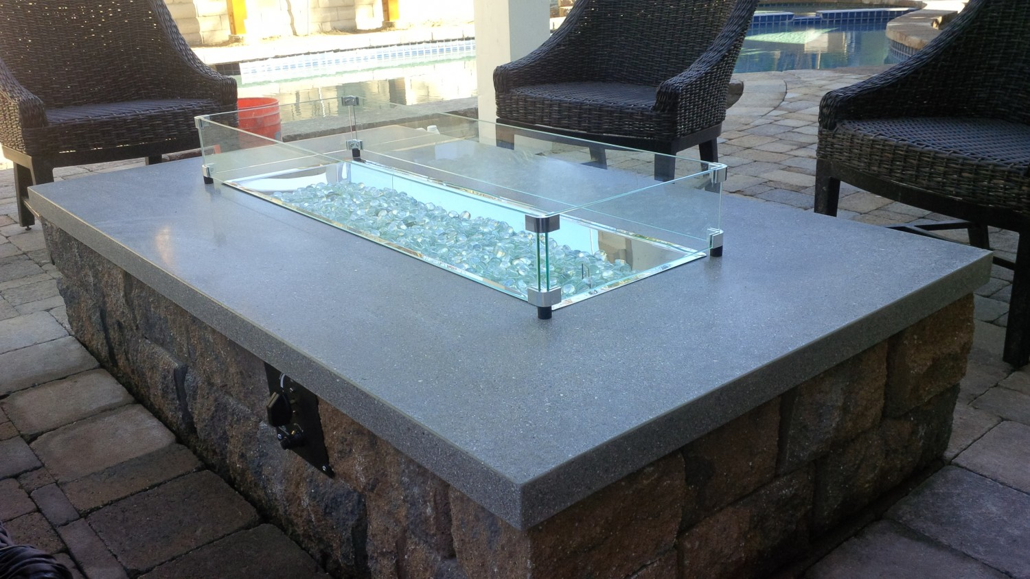pit with glass rocks fireplace design ideas