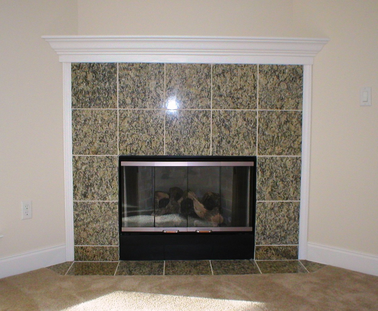 Granite tile fireplace surround fireplace design ideas for Marble for fireplace surround