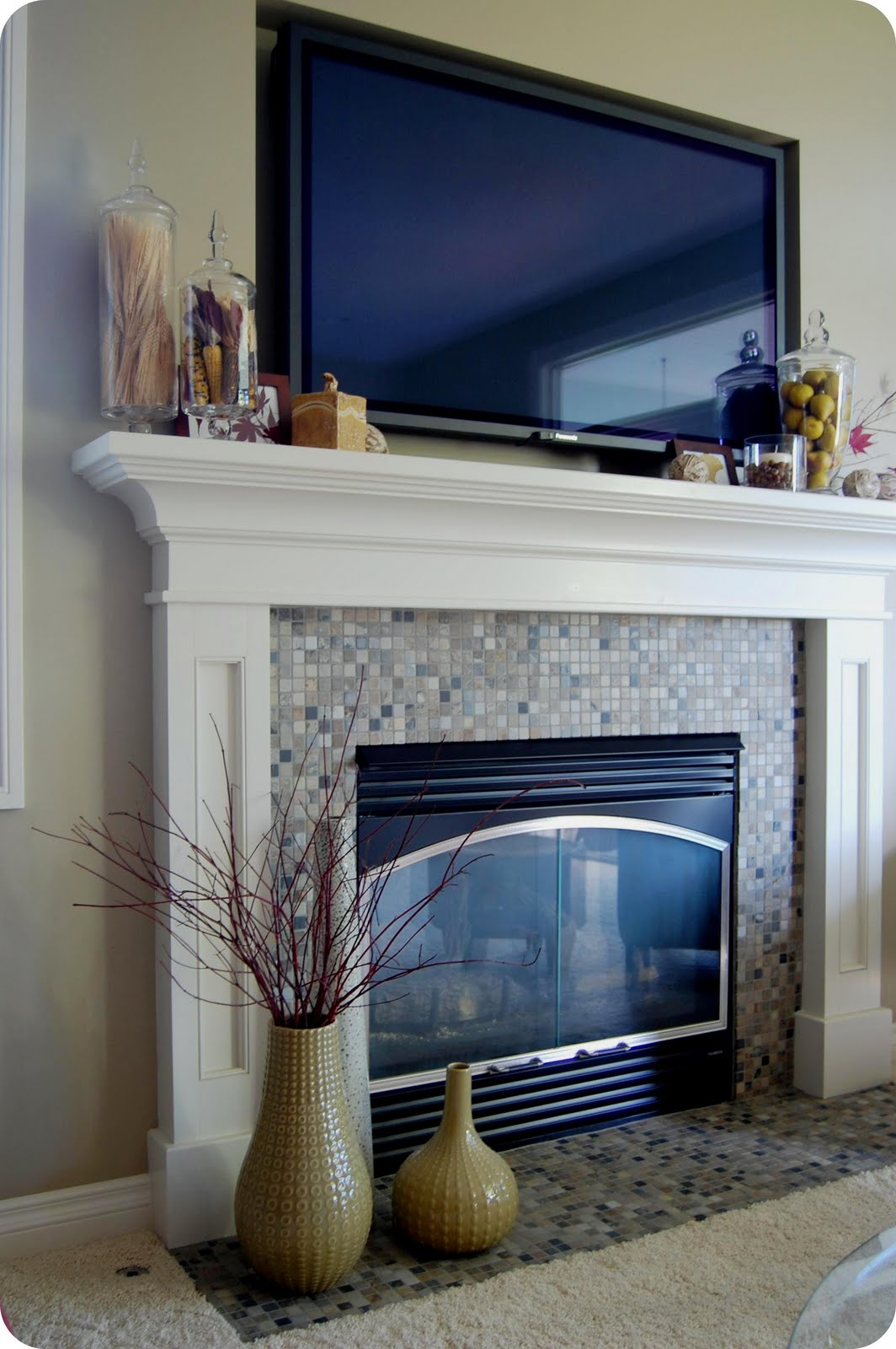 How to decorate a fireplace mantel with a tv fireplace for Decor over fireplace