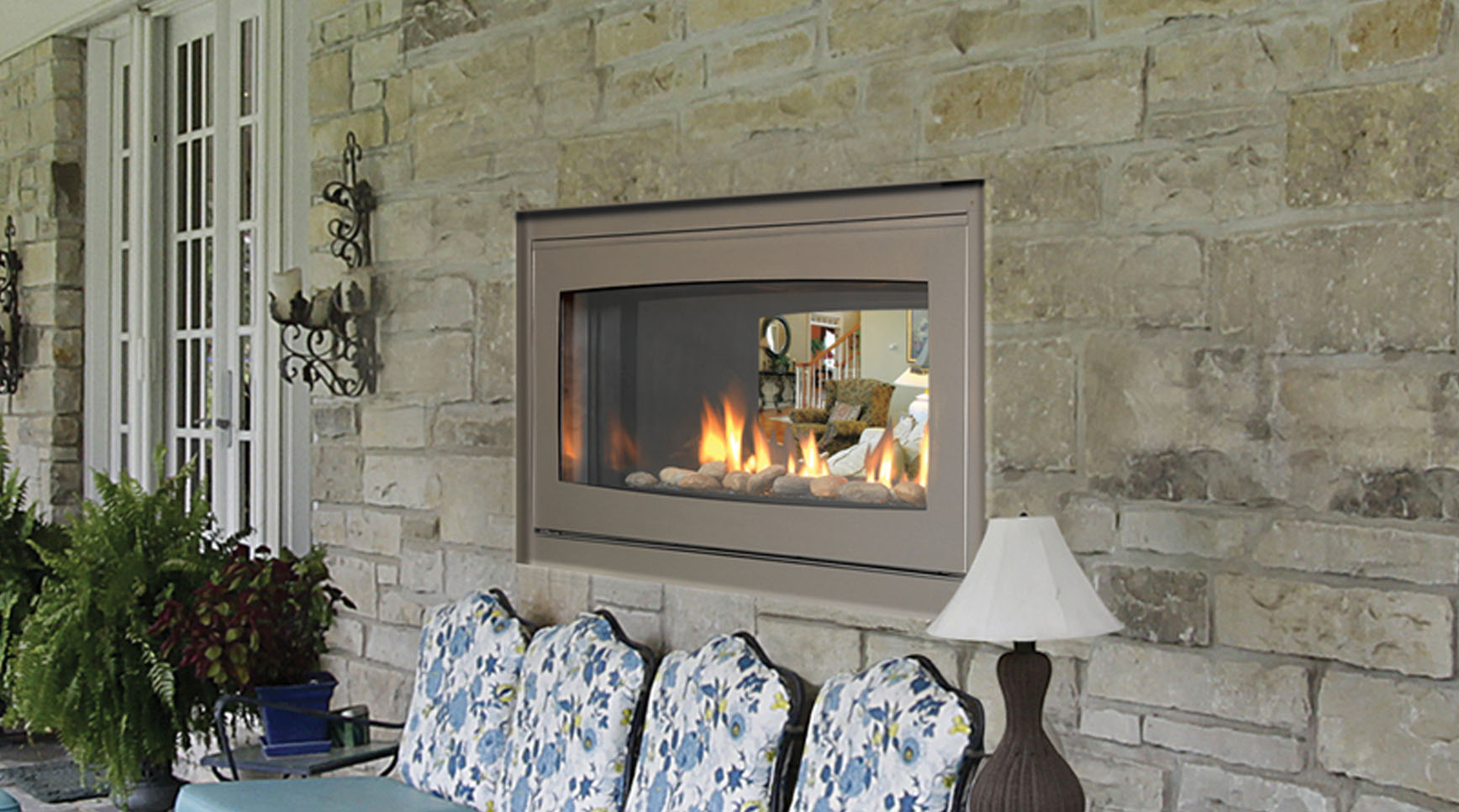 An indoor outdoor fireplace adds a beautiful feature to your homes outdoor living room; they also have a unique combination of function and flexibility. They