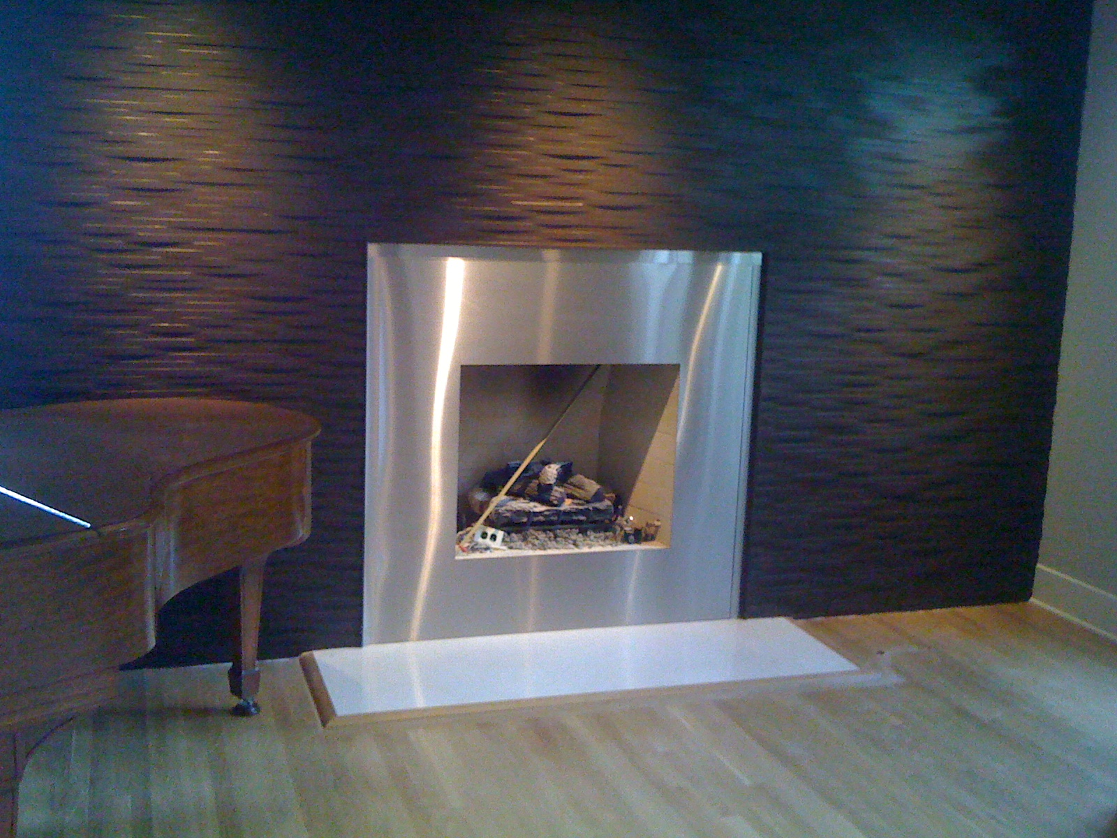 Metal fireplace surround is definitely eye-catching