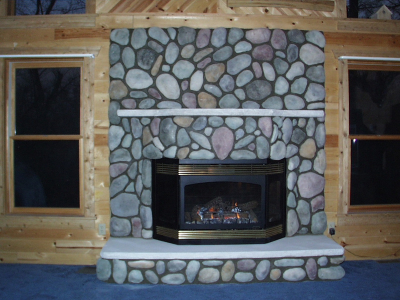 Give A Makeover To Your House With A River Rock Fireplace