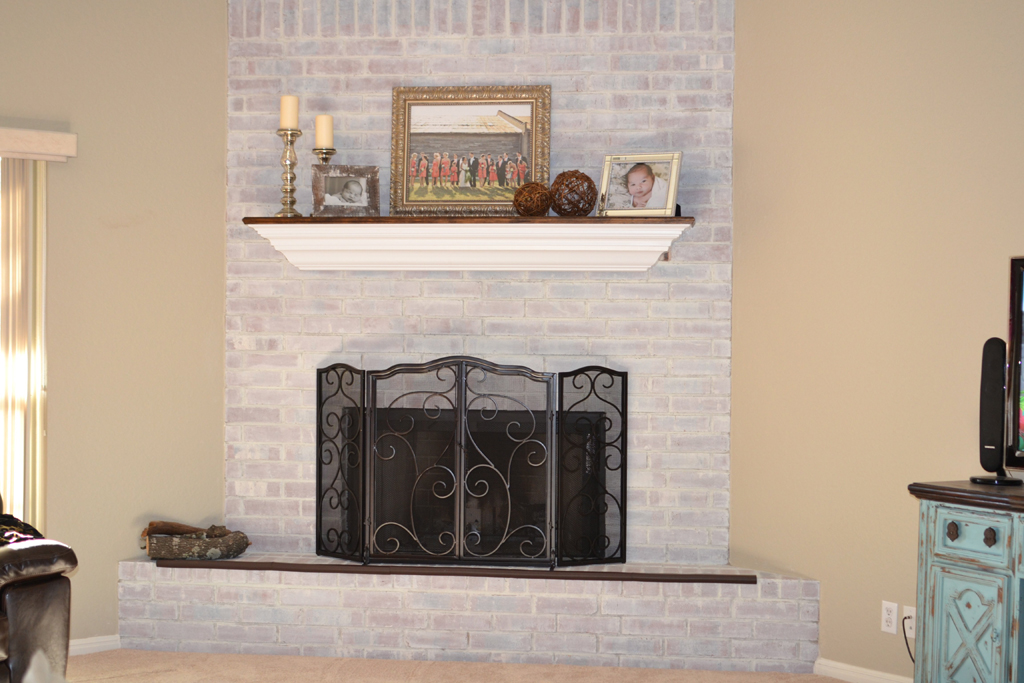 White Painted Stone Fireplace
